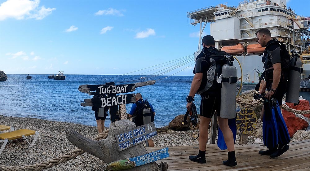 Divers Entering Tugboat Beach